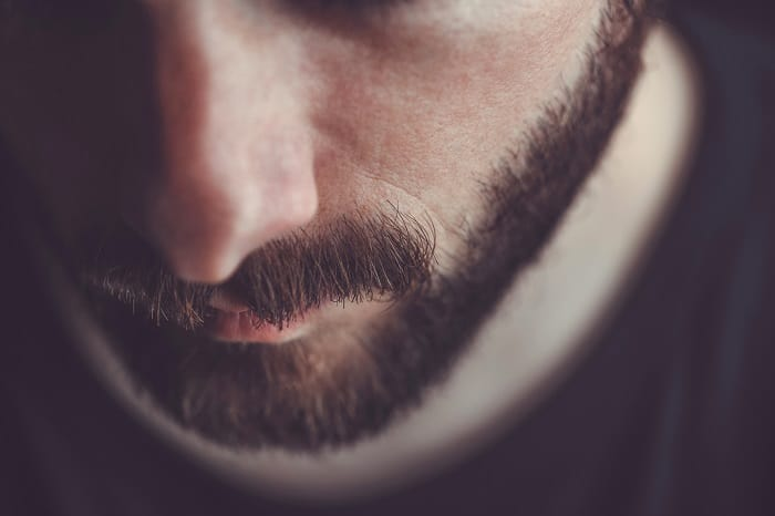Why does mustache grows slower than beard?